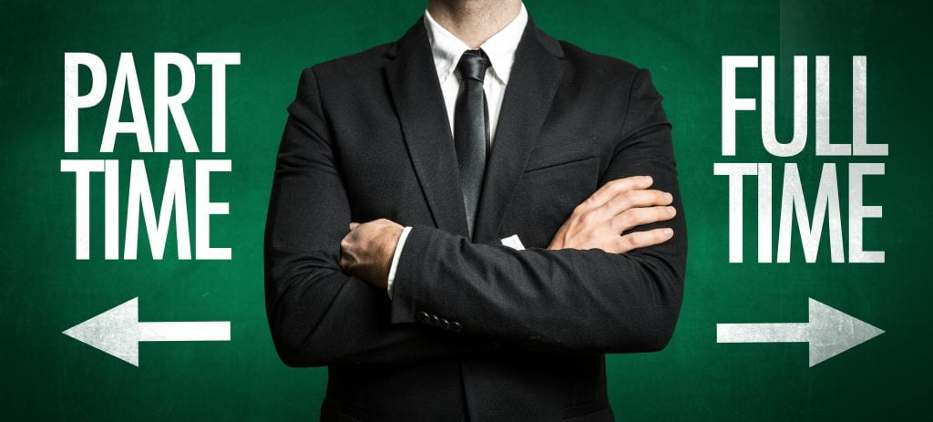 Man in black suit in middle of the photo with a part time arrow pointing to his left side and a full-time arrow pointing to this right side. Colors are green, black, and white