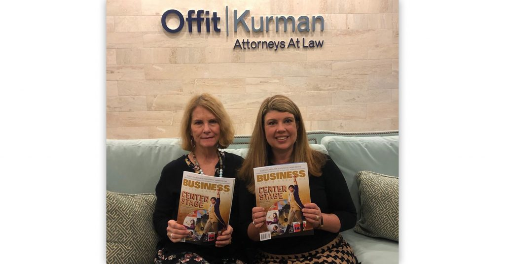 Offit Kurman Attorneys Mitchell Kelling and Beth Hodges awards the Business North Carolina Legal Elite-both holding up Business North Carolina magazines and smiling
