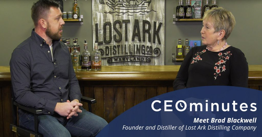 Brad Blackwell, Founder of Lost Ark Distilling Company being interviewed by an older woman.