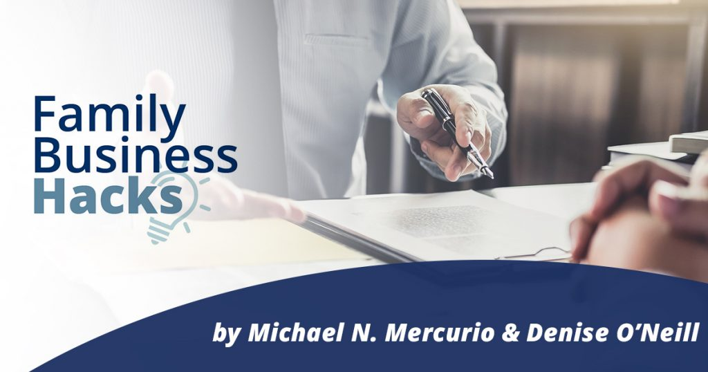 Family Business Hacks logo on left side of photo with a man holding a pen and signing an agreement on paper- by Michael N. Mercurio & Denise O'Neill