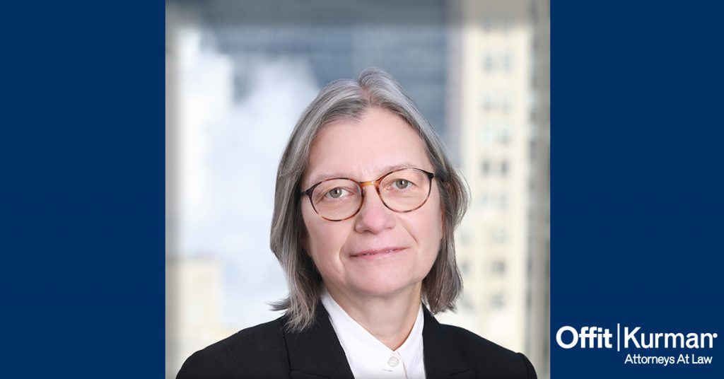 Headshot of Margaret Carmeli surrounded by two dark blue pillars and offit Kurman attorneys at law logo in the bottom left of photo
