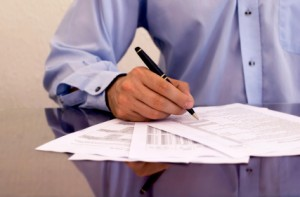businessman signing papers
