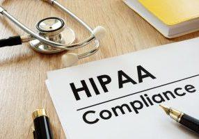 Hipaa,Compliance,Application,And,Stethoscope,On,A,Desk.
