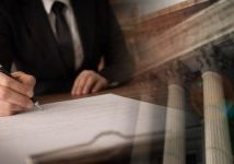 legislation law legal concept. lawyer signing legal document and agreement with court background. wide view.