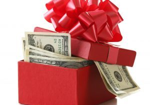 Bundle,Of,Dollars,In,Present,Box,With,Bow,Isolated,On