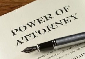 power of attorney document with silver fountain pen
