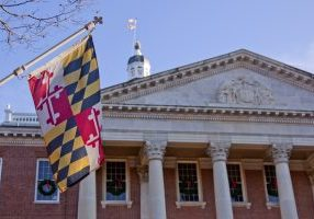 maryland flag hanging outside of a courthouse