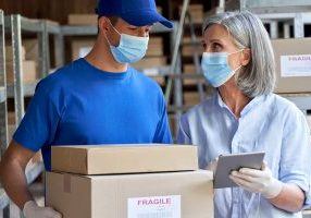 warehouse masked workers shutterstock