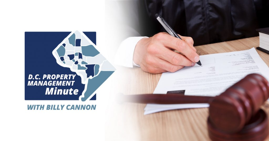 D.C. property management minute with billy cannon with a man signing a document on a table