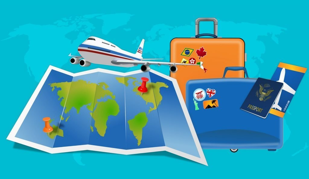 picture of a world map, a white airplane with red and blue stripes, an orange suitcase, a passport and ticket, and a blue suitcase with stickers on it