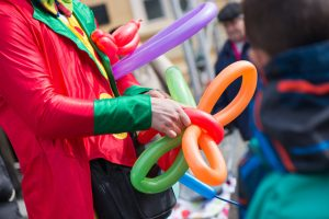 clown tying a balloon