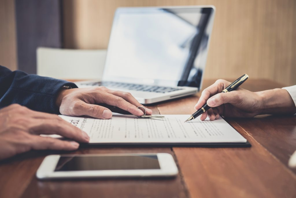 Sales manager filing keys to customer after signing rental lease contract of sale purchase agreement, concerning mortgage loan offer for and house insurance. F
