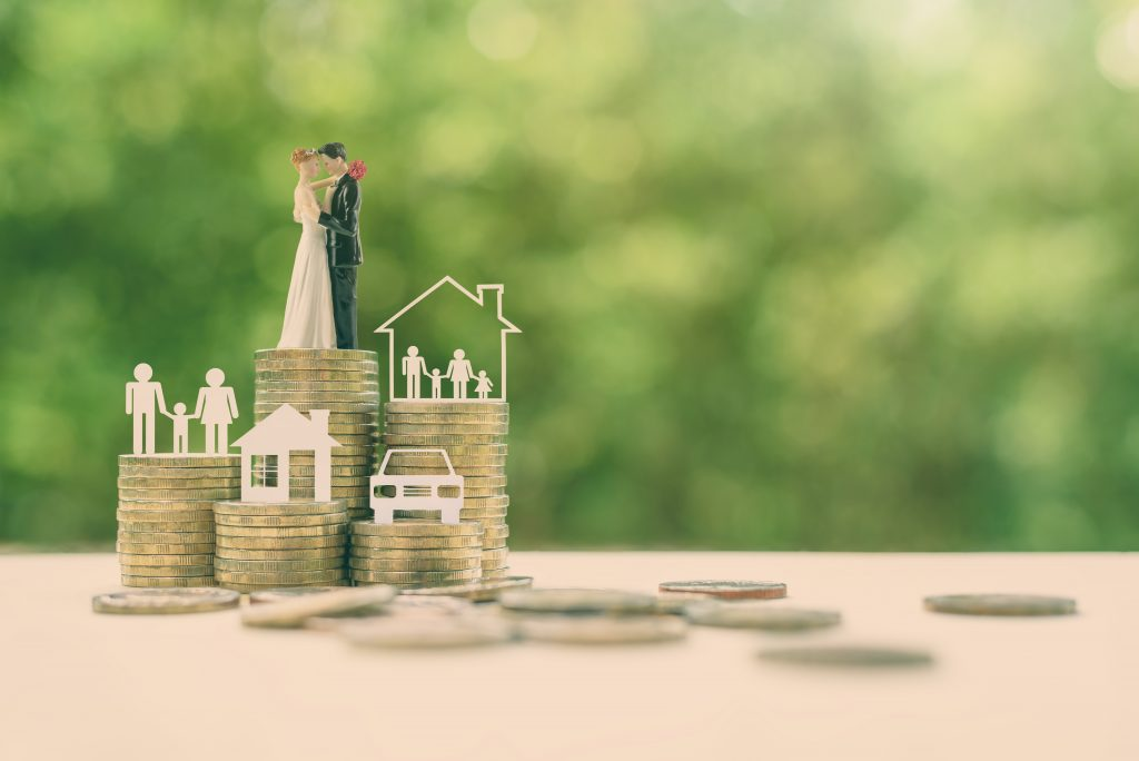 Sustainable financial goal for family life or married life concept : Miniature wedding couple, parent & child, a house or home, a car on rows of rising coins, depicts savings or growth for new family W