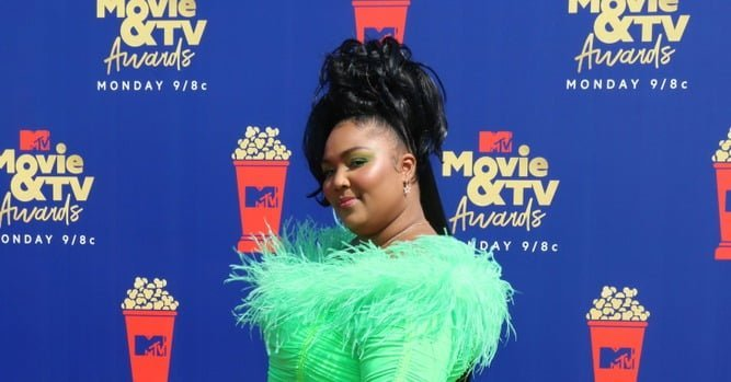 Lizzo at the MTV Movie & TV Awards in a neon green dress.