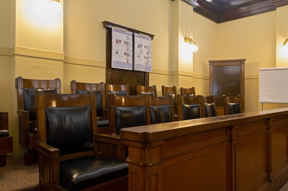 brown juror chairs inside a court room