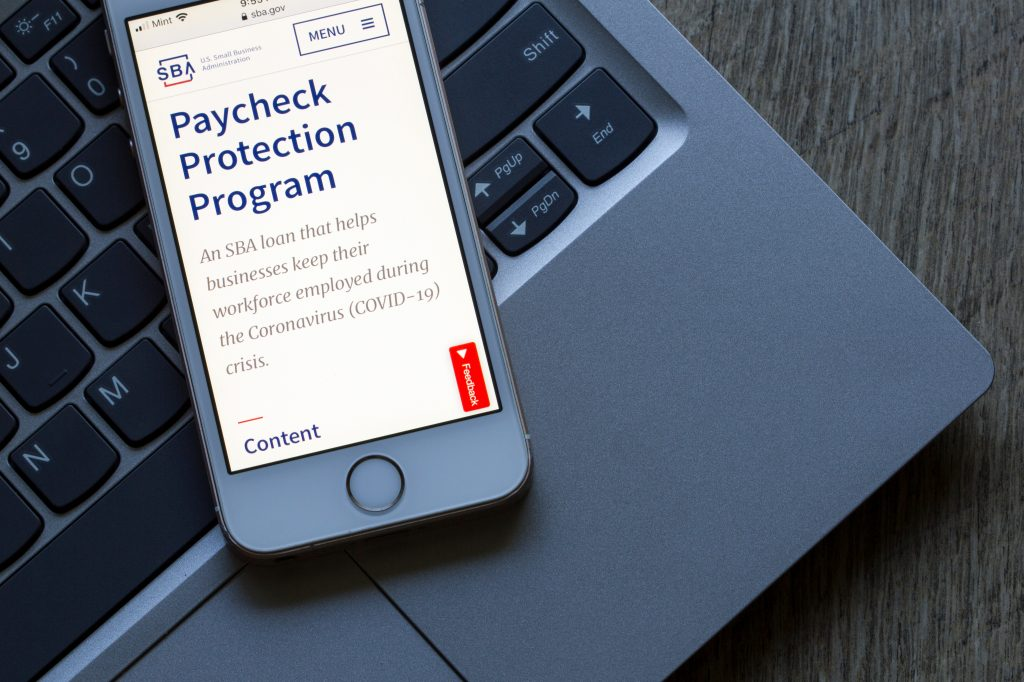 The U.S. Small Business Administration website's Paycheck Protection Program (PPP) page is seen on a phone. PPP loan helps businesses keep their workforce employed.