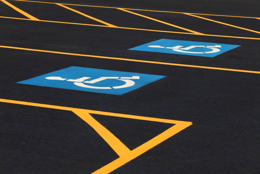 The international markings for a handicapped parking stall in a parking lot.