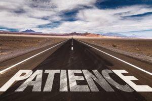 Patience written on desert road