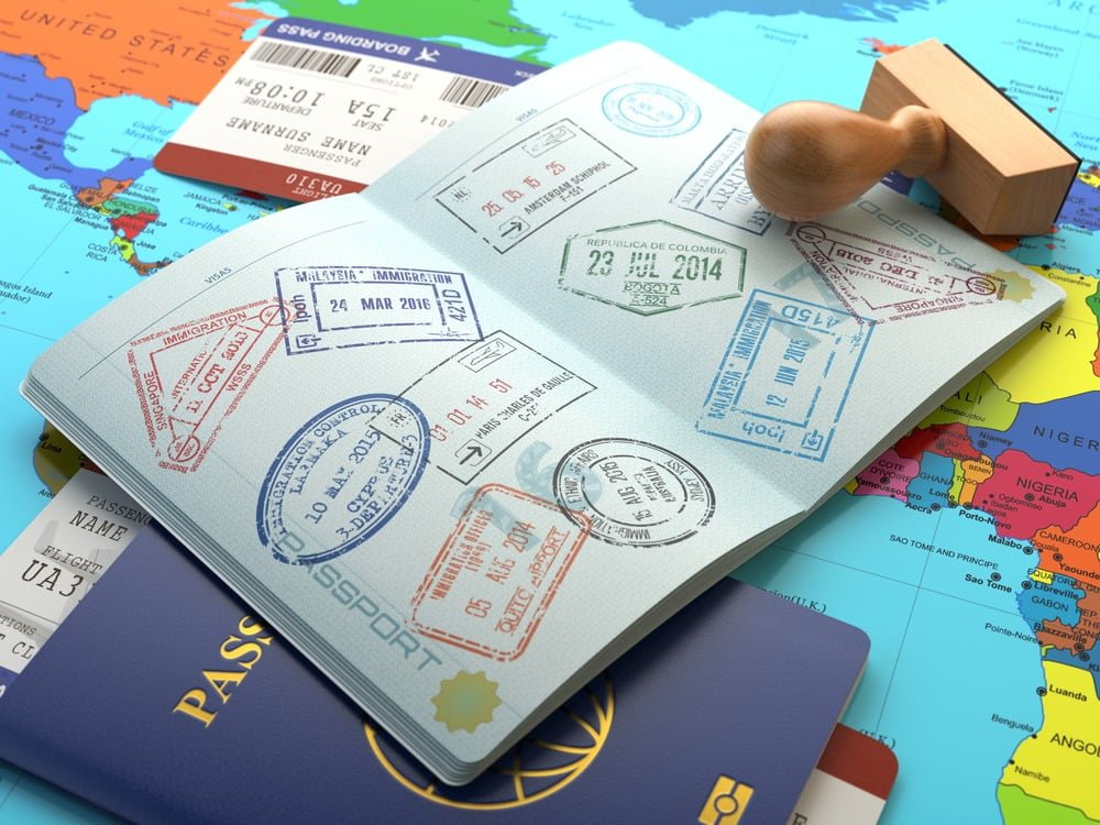 passport book with lots of locations cancelled or stamed out in many colors