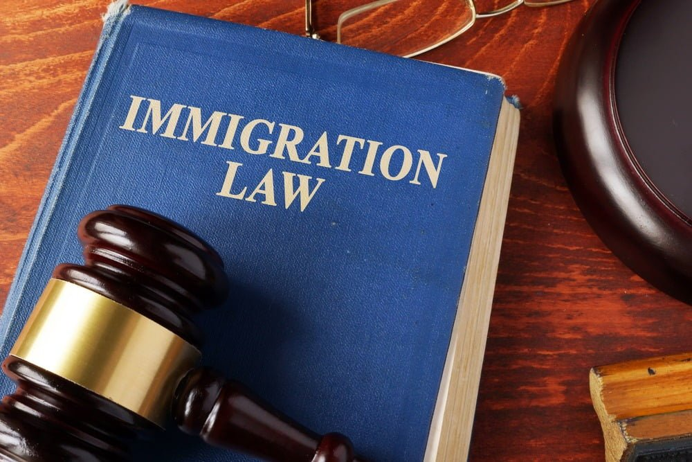 Book with title immigration law on a table