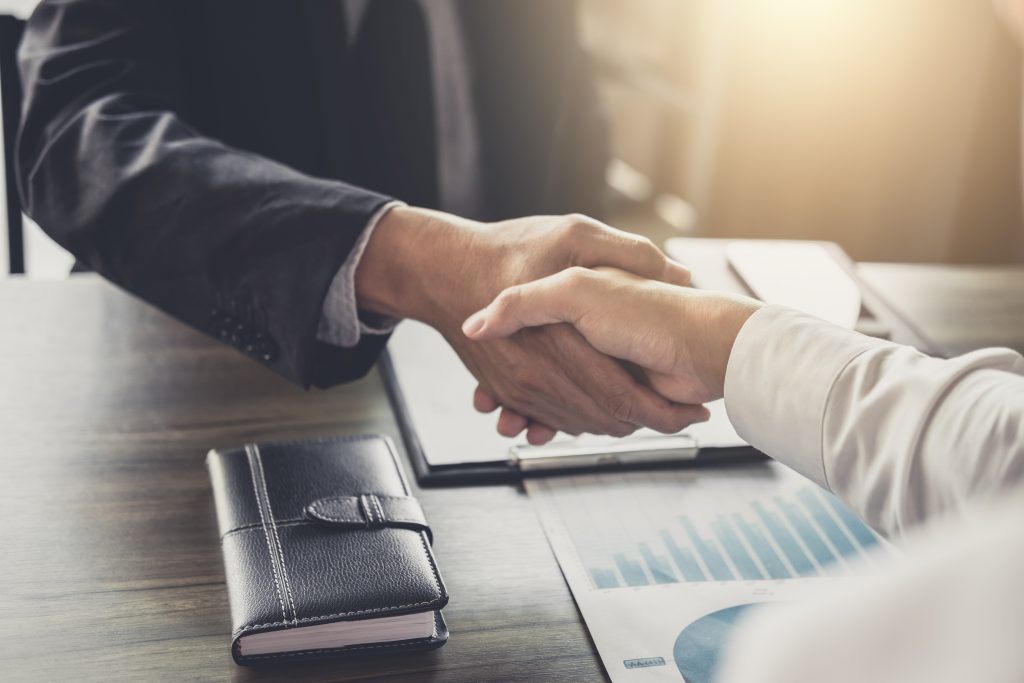 Two confident Business handshake and business people after discussing good deal of Trading contract and new projects for both companies, success, partnership, co worker. F