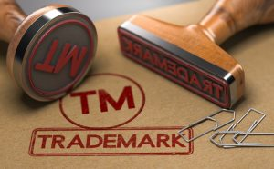 Trademark writing in red on brown wood